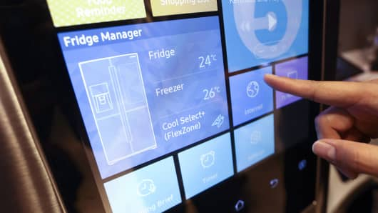 An employee demonstrates connecting to the internet on a Samsung Electronics Family Hub fridge freezer.