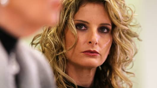 Summer Zervos listens as her attorney Gloria Allred speaks during a news conference announcing the filing of a lawsuit against President-elect Donald Trump in Los Angeles, January 17, 2017.