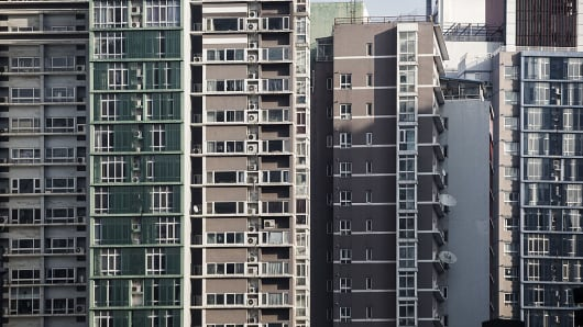 Residential buildings stand in Beijing, China on Friday, Nov. 25, 2016.