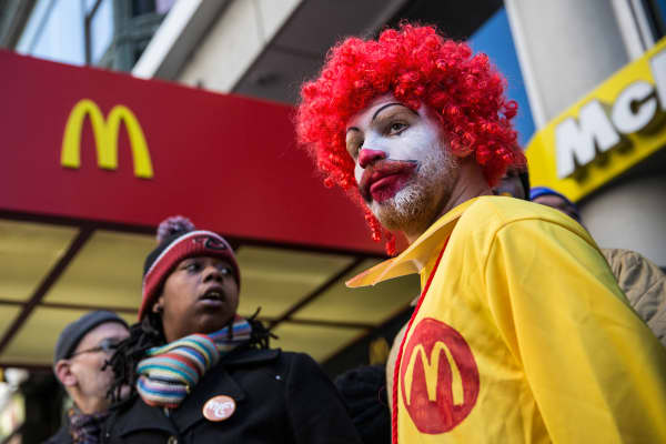 A man named Ben, who chose not to give his last name, dressed as the McDonald's mascot Ronald McDonald, participates in a protest for higher wages for fast food workers in New York City.