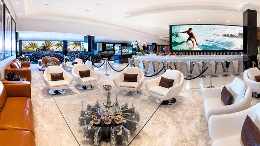 The 30-foot TV screen in this lounge is said to be the largest TV in any residential home.
