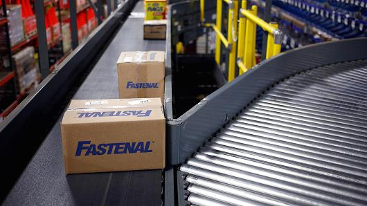 Boxes of hardware move down a conveyor belt inside the Fastenal Co. distribution center in Jessup, Pennsylvania.