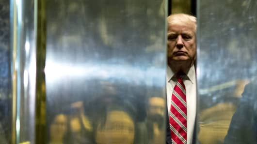 President-elect Donald Trump boards the elevator to the lobby after meetings at Trump Tower in New York City on January 16, 2017.