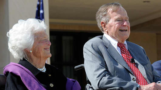 Former President George H.W. Bush sits with his wife, Barbara, during the dedication ceremony of the George W. Bush Presidential Center in Dallas, on April 25, 2013.