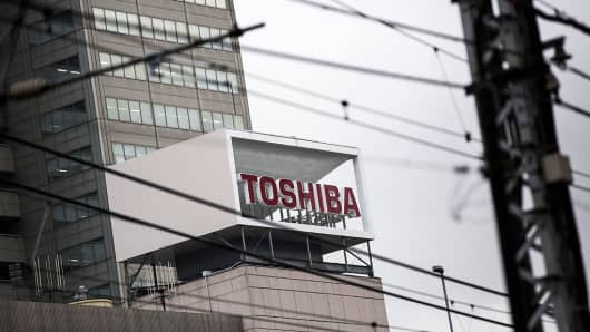 The logo of Toshiba Corporation is displayed at the company's headquarters in Tokyo on December 27, 2016.