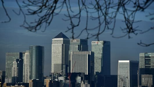 The financial offices of banks, including JPMorgan Chase, Citi, HSBC, and other institutions in the financial district of Canary Wharf, are pictured from Greenwich Park in London on January 17, 2017.