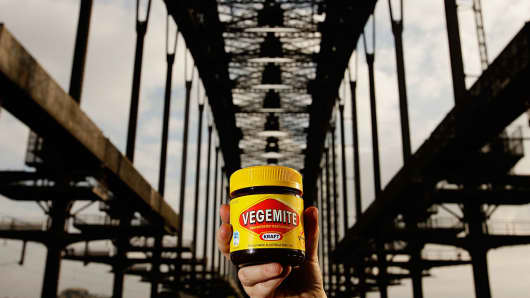 A woman holds a jar of Vegemite during a picnic breakfast on the Sydney Harbour Bridge, Australia.