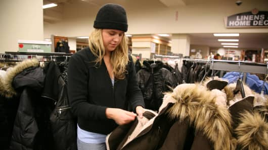 A woman shops for coats at a Burlington Coat Factory store in White Plains, New York.