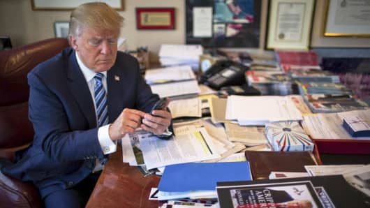 Donald Trump demonstrates his tweeting skills in his office at Trump Tower in New York, Sept. 29, 2015.