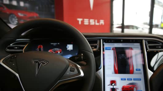 The inside of a Tesla vehicle is viewed as it sits parked in a Tesla showroom and service center in Red Hook, Brooklyn on July 5, 2016.