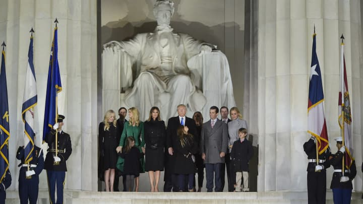 President-elect Donald Trump and family pose at the end of a welcome celebration at the Lincoln Memorial in Washington, DC, on January 19, 2017.