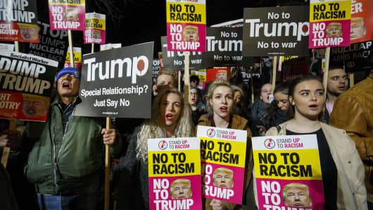 People protest against the inauguration of the 45th President of the United States, Donald Trump outside the London US Embassy in London, United Kingdom on January 20, 2017.