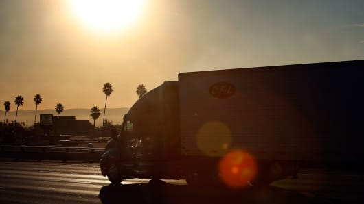 A truck travels the 210 freeway between Los Angeles and cities to the east near Pasadena, California.