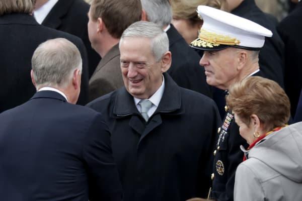 Donald Trump's Defense Secretary Gen. James Mattis (C) arrives on the West Front of the U.S. Capitol on January 20, 2017 in Washington, DC.