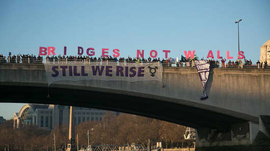 Banners were dropped on bridges crossing the Thames in protest against the inauguration of Donald Trump, January 21st 2017 in London.
