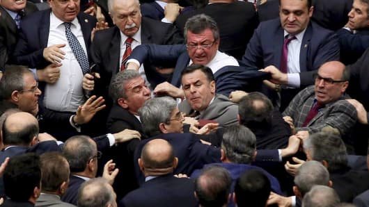 Ruling Justice and Development Party and main opposition Republican People's Party lawmakers scuffle at the parliament in Ankara during deliberations over a controversial 18-article bill to change the constitution to create an executive presidency January 11, 2017.