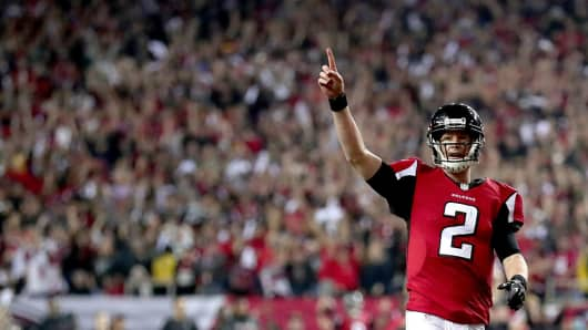 Matt Ryan #2 of the Atlanta Falcons reacts after a touchdown in the fourth quarter against the Green Bay Packers in the NFC Championship Game at the Georgia Dome on January 22, 2017 in Atlanta, Georgia.