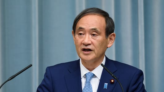 Yoshihide Suga, chief cabinet secretary of Japan, speaks during a press conference.