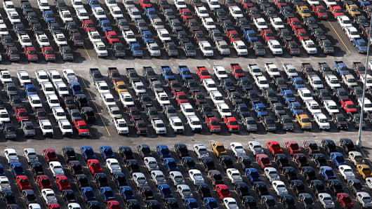 Ford trucks parked in a lot in 2008 when U.S. automakers were hit by plummeting auto sales.