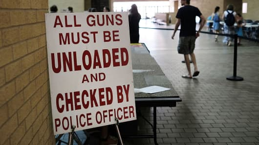 A sign posted outside a gun show in Fort Worth, Texas.