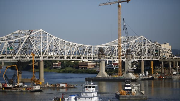 Construction crews work to erect a new highway bridge to carry I-65 traffic across the Ohio River to southern Indiana as a part of the Ohio River Bridges Project in Louisville, Kentucky.