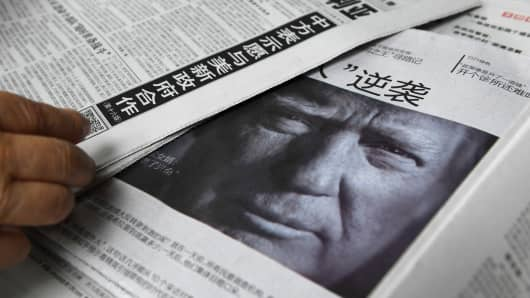 A newspaper featuring a photo of US President Donald Trump at a news stand in Beijing