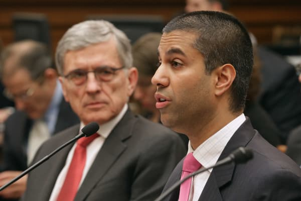 Federal Communications Commission Commissioner Ajit Pai (R) and FCC Chairman Tom Wheeler.