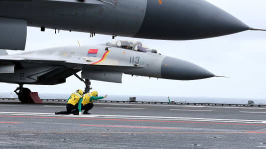 This photo taken on January 2, 2017 shows Chinese J-15 fighter jets on the deck of the Liaoning aircraft carrier during military drills in the South China Sea.
