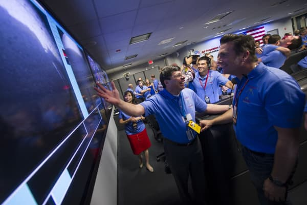 Adam Steltzner (right) and fellow NASA employees react to the Curiosity rover landing on Mars on Aug. 5, 2012.