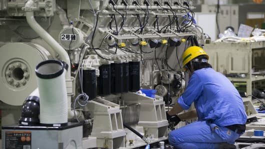 A worker assembles an engine at the Mitsubishi Heavy Industries Engine & Turbocharger plant in Sagamihara, Kanagawa Prefecture, Japan, on Monday, July 4, 2016.