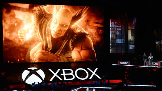 Katsuhiro Harada (R), and Michael Murray introduce 'Tekken7' video game during Microsoft Corp. Xbox at the Galen Center on June 13, 2016 in Los Angeles, California