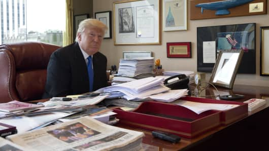 Republican presidential candidate Donald Trump is photographed during an interview with The Associated Press in his office at Trump Tower in New York, Tuesday, May 10, 2016.