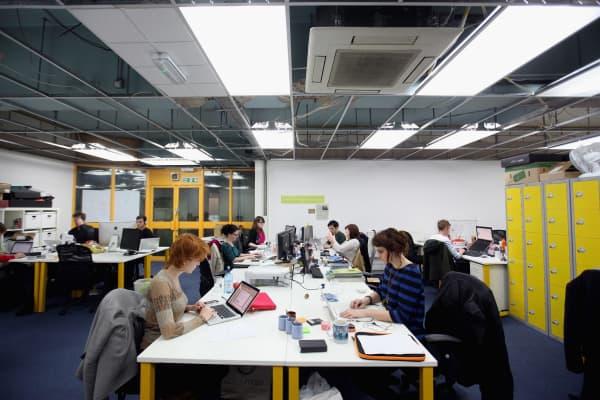 People work at computers in TechHub in London, England
