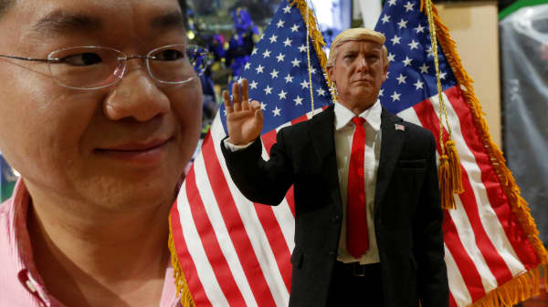 DID Corporation CEO Howard Cheung poses with a prototype 12-inch action figure of U.S. President Donald Trump, which will be available in March, in Hong Kong, China January 21, 2017.