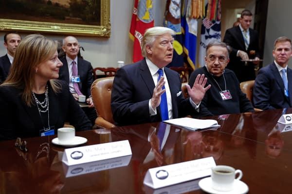 President Donald Trump meets with CEO of General Motors Mary Barra (L), CEO of Fiat Chrysler Automobiles Sergio Marchionne (2nd R) and Fiat Chrysler Head of External Affairs Shane Karr (R) in the Roosevelt Room of the White House on January 24, 2017 in Washington, DC.