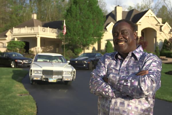 Steve Hightower in front of his 11,000 square foot house.
