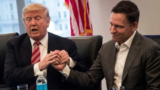 Then-president-elect Donald Trump shakes the hand of Peter Thiel during a meeting with technology executives at Trump Tower, December 14, 2016 in New York City.