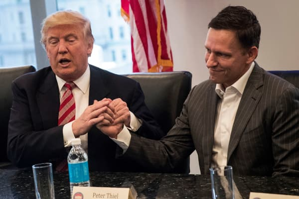President-elect Donald Trump shakes the hand of Peter Thiel during a meeting with technology executives at Trump Tower, December 14, 2016 in New York City.