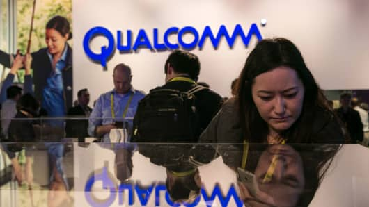 People crowd into the Qualcomm booth to view a series of new products during the annual Consumer Electronics Show