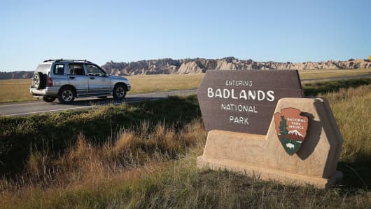 Visitors drive into the Badlands National Park near Wall, South Dakota.