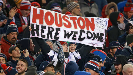 As the Patriots victory draws to a close on January 22, 2017, a fan holds a sign for the upcoming trip to the Super Bowl in Houston.