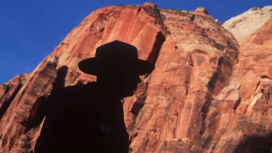 A silhouette of a U.S. National Park ranger