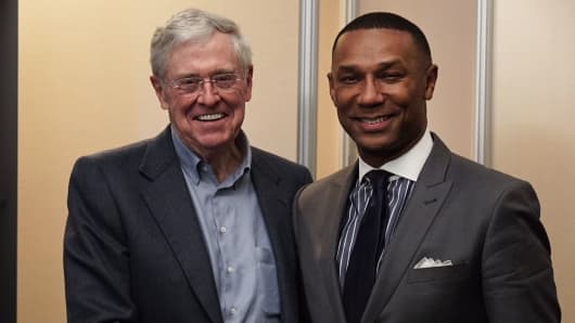 Charles Koch with Johnny Taylor, CEO of the Thurgood Marshall College Fund (TMCF)