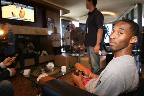 Kobe Bryant playing Playstation.