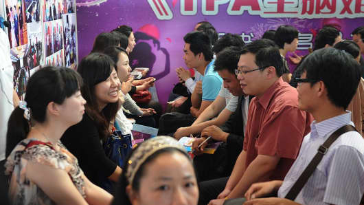 People participate in a speed dating event in Shanghai on May 21, 2012.