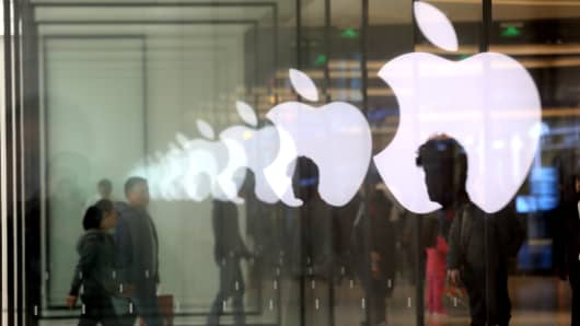 Customers come to the newly opened Apple store on December 10, 2016 in Shanghai, China.