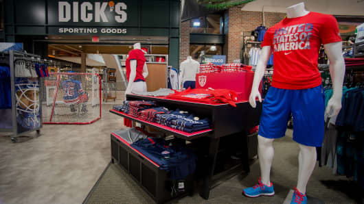 Mannequins stand next to merchandise displayed for sale at a Dick's Sporting Goods store in West Nyack, New York.