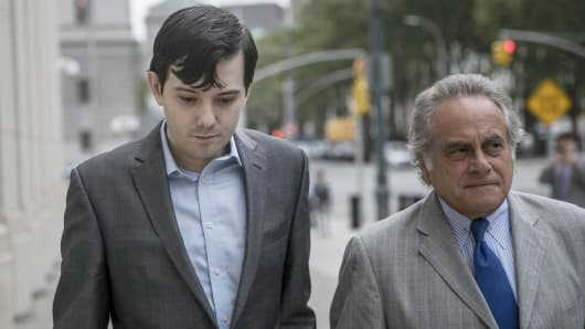 Martin Shkreli, former chief executive officer for Turing Pharmaceuticals AG, left, arrives at Federal Court with his attorney Benjamin Brafman in Brooklyn, New York, U.S, on Thursday, July 14, 2016.