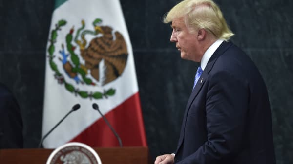 Donald Trump leaves after a joint press conference with Mexican President Enrique Pena Nieto (out of frame) in Mexico City on August 31, 2016.
