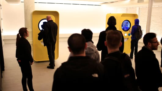 Customers stand in line to purchase Snapchat Spectacles by Snap Inc. inside the company's pop-up store in New York, on Monday, Dec. 5, 2016.